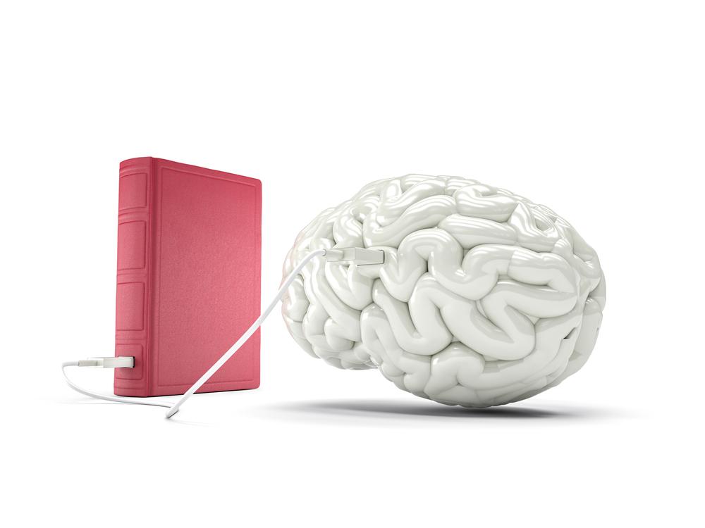 Image d'un livre et d'un cerveau
