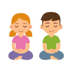 Un garçon et une fille faisant de la méditation